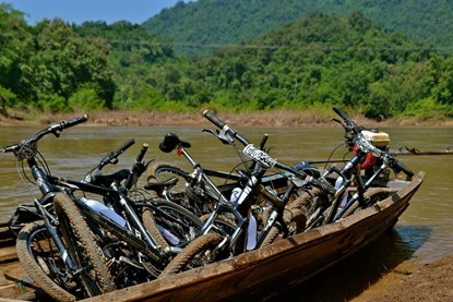 Cross river by boat - Laos Biking Tour