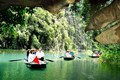 Take a row boat in Tam Coc river