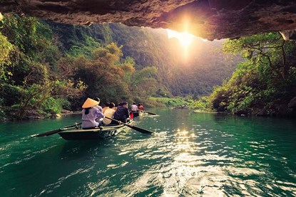Take a row boat in Trang An